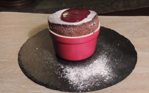 Chocolate soufflé with strawberry coulis