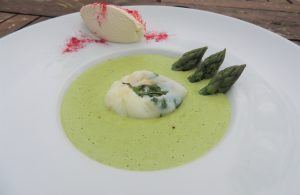 Asparagus velouté, herbs poached egg and smoked Chantilly