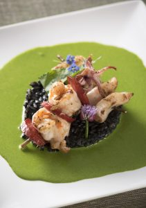 King prawn, squid and monkfish rosemary skewers with squid ink pilaf rice and sorrel cream sauce
