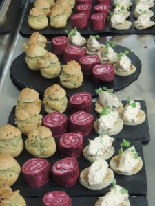 Tapenade of green olive in a choux bun Smoked salmon rillettes on toast Roll of cured ham and cream cheese
